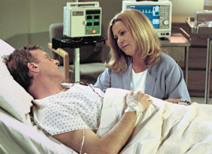 Playing the dedicated wife, Hicks with her onscreen husband.