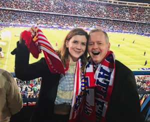 Maggie Holland and her father Dan at an Atlético Madrid game on a trip to Spain in February 2017.